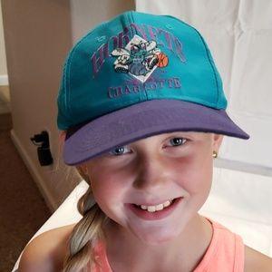 Charlotte Hornets snapback hat.